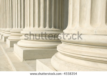 A row of columns at the entrance to the US Supreme Court in Washington, DC. - stock photo