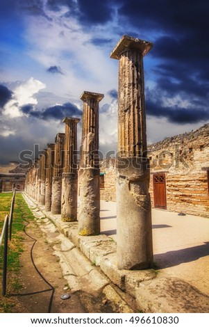 A row of columns in the ruins of the ancient town of Pompeii, Italy