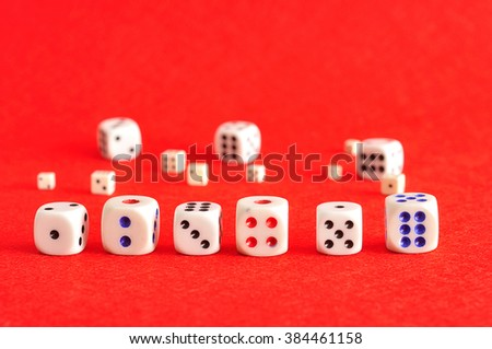 A row of dices from number one to six and some more that is out of focus  - stock photo