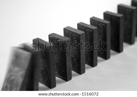 A row of dominoes falling - stock photo