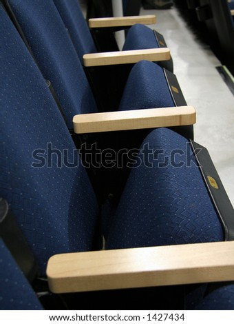 A row of empty seats at an arena or theater - stock photo