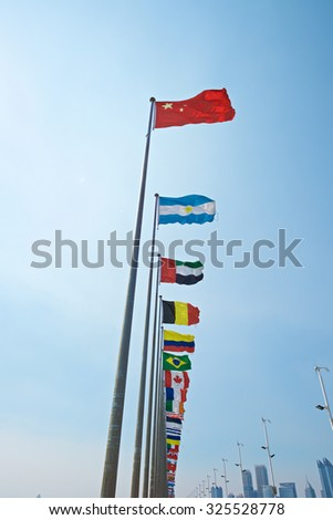 A row of flags with Chinese flag leading other nation. Rise of China