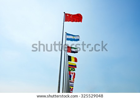 A row of flags with Chinese flag leading other nation. Rise of China - stock photo