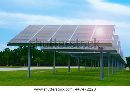 A row of huge solar panels producing electricity power from the sun - stock photo
