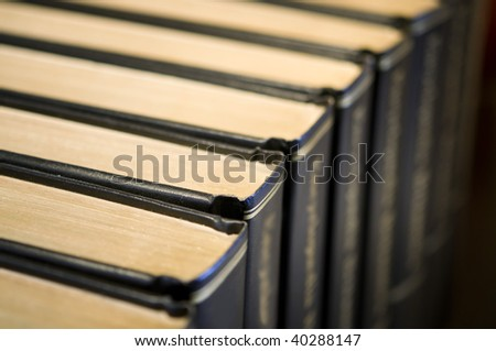 A row of leather bound books - stock photo
