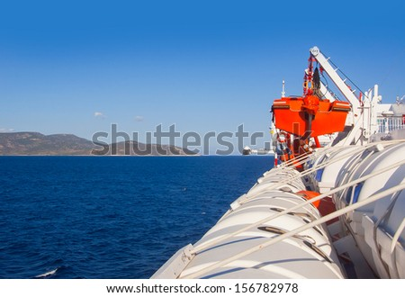 A row of lifeboats on a cruise ship - stock photo
