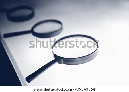 A row of magnifiers to magnify on a white table.