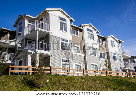 A row of new townhouses from backside view - stock photo
