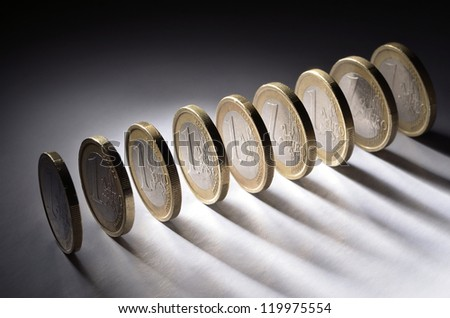 A row of one euro coins - stock photo