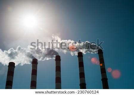 a row of power plant chimney , emit large amounts of smoke  - stock photo