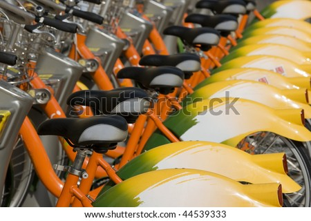 A row of public bicycles.  These bikes are part of the public transport system in Taipei, Taiwan. This helps to reduce traffic and keep the city greener.