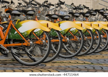 A row of public bicycles.  These bikes are part of the public transport system in Taipei, Taiwan. They help made Taipei Greener.