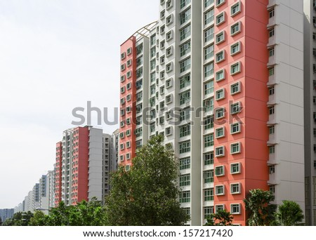 A row of red color housing apartment.