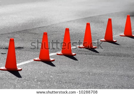 A row of safety cones blocking off a road - stock photo