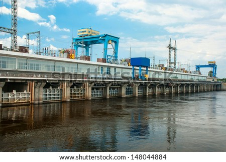 A row of spillway gates on the Kanev hydroelectric power plant, the Dnieper River, Ukraine - stock photo