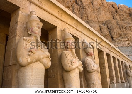 A row of statues of Queen Hatshepsut as Osiris, the god of the dead, at her temple in Luxor (Thebes), Egypt. - stock photo