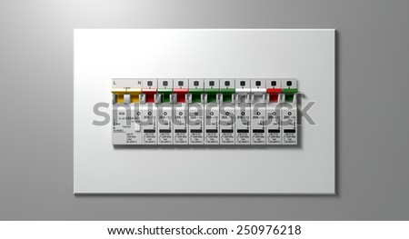 A row of switched on household electrical circuit breakers on a wall panel - stock photo