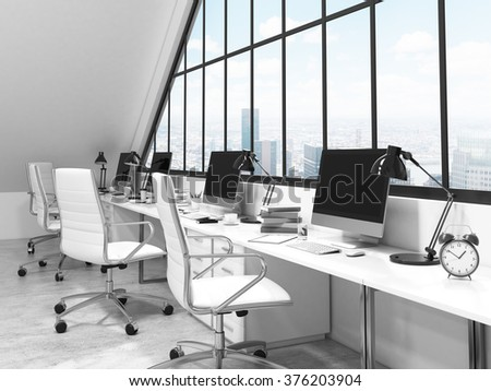 A row of tables in front of the panoramic window in an office in an attic. Computers and stuff on them. City view. Concept of a modern office. 3D rendering - stock photo
