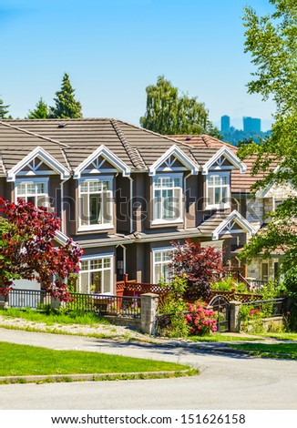 A row of townhouses on street in suburban of New Westminster, British Columbia. - stock photo