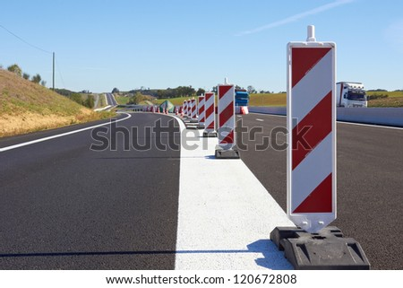 A row of  traffic signs set on the road