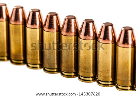 a row of unused 9mm bullets isolated on white - stock photo