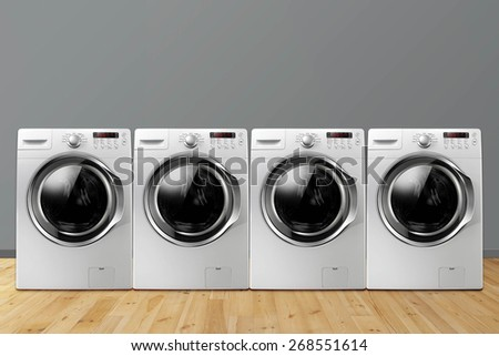 A Row of Washing Machines in Room - stock photo
