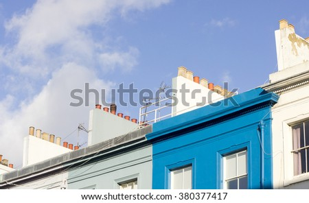A row of white and blue painted town houses in London