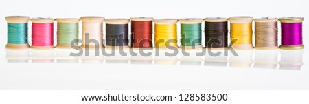 A row sewing thread with reflection - stock photo
