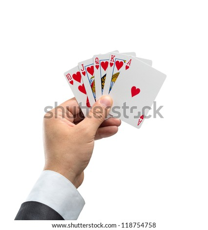 A royal flush in hearts in hand isolated on white background - stock photo
