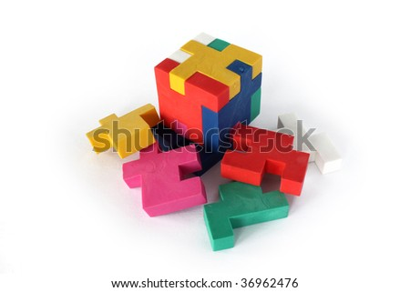 A rubber puzzle on an white background - stock photo