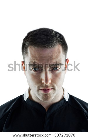 A rugby player looking down on a white background