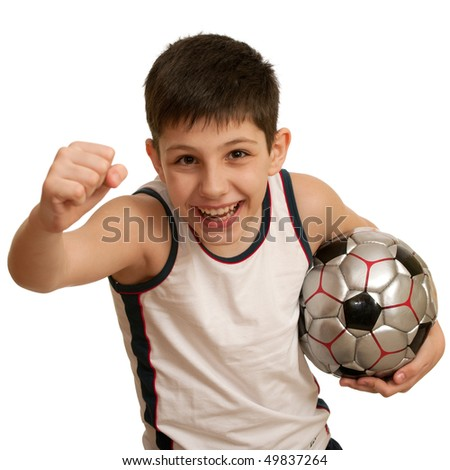 A running teen holding a soccer ball; isolated on the white background - stock photo