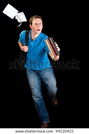 A running university student (humour) - stock photo
