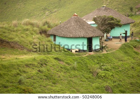 A rural huts in South Africa with children playing - stock photo