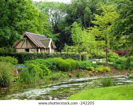 A rural landscape of a cottage and river.
