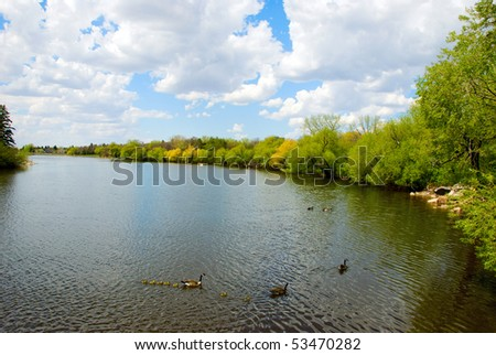 A rural landscape with going out river. - stock photo