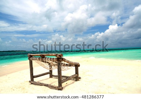 A rustic chair on the beach.