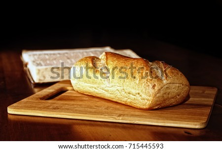 Rustic Loaf Bread On Wood Cutting Stock Photo Download Now