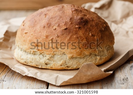 A rustic loaf of home made bread - stock photo