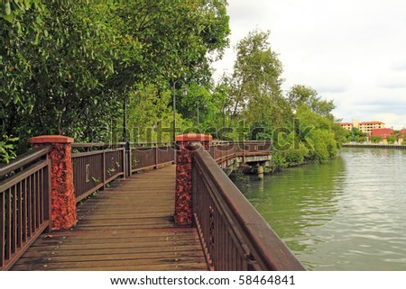 A rustic river walkway along the Malacca river in the historical town of Malacca, Malaysia. - stock photo