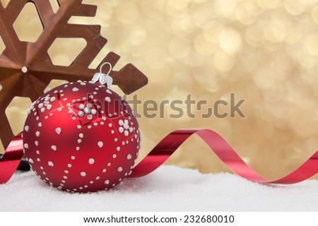 A rustic star and Christmas decorations on a gold glitter background - stock photo