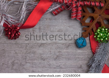 A rustic star and ribbons on a weathered wooden table - stock photo