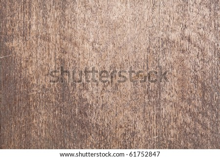 A rustic weathered plywood surface. - stock photo