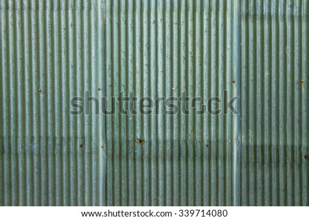A rusty corrugated iron metal fence close up/ Zinc wall - stock photo