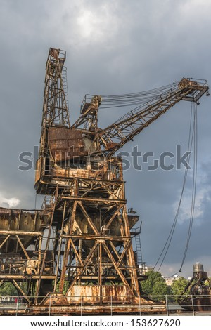 A rusty, derelict crane at the abandoned Battersea power station, London, UK