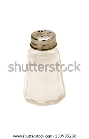 A rusty salt cellar, quite full, isolated on white background. - stock photo