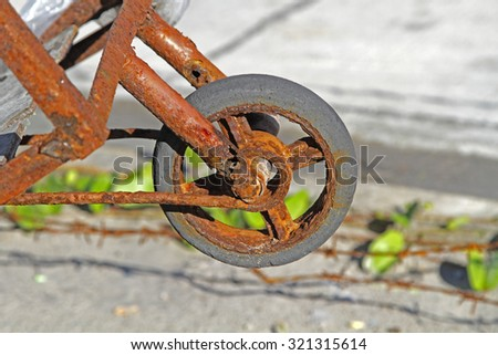 A rusty wheel barrow.