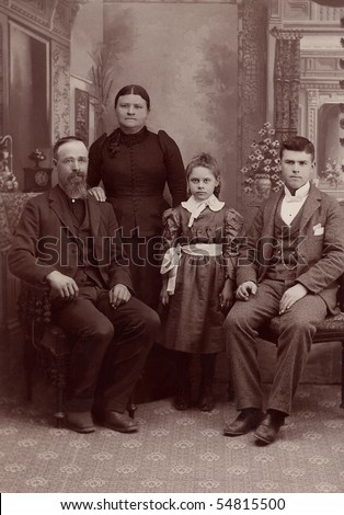 A 1800's antique vintage portrait photograph of a family posing for the camera. It is a studio formal photo of a Quaker family. - stock photo