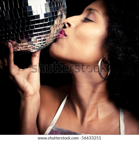 a 70s style disco girl with a mirror ball - stock photo