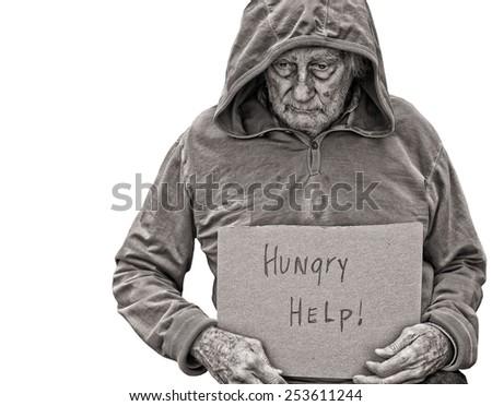 A sad Senior Homeless man isolated on white - stock photo